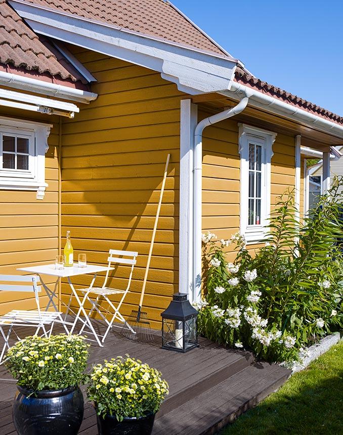 Velg en gul farge på huset